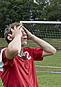 Frustrated soccer player on field - STKF000676