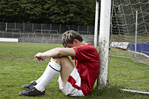 Frustrated soccer player on field - STKF000672