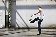 Man playing street soccer - STKF000678