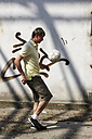 Man playing street soccer - STKF000680