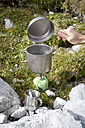 Austria, Tyrol, Karwendel mountains, Man boiling water on gas cooker - TK000181