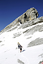 Austria, Tyrol, Karwendel mountains, Mountaineers crossing snowfield - TKF000184