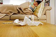 Sick woman lying on sofa - HOH000253