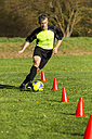 Soccer player passing a slalom course - STSF000222