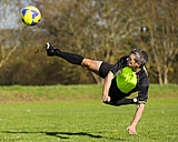 Soccer player kicking ball - STSF000219