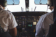 Two pilots in the cockpit of a Dornier 228 - MBE000853
