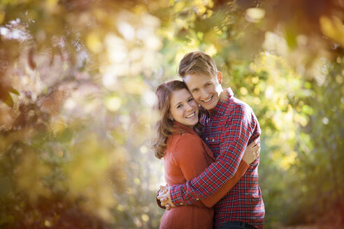 Happy young couple enjoying autumn in a park - BGF000036