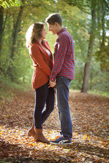 Happy young couple enjoying autumn in a park - BGF000029