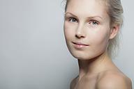 Portrait of smiling young woman, studio shot - BGF000048