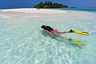 Maledives, young woman snorkelling in a lagoon - AMF001226