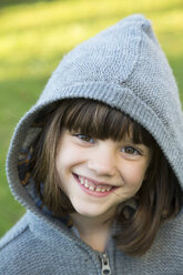 Portrait of smiling little girl wearing hooded jacket - LVF000331