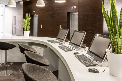 Poland, Warsaw, reception desk at hotel - MLF000193
