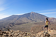 Spain, Canary Islands, Tenerife, Roques de Garcia, Mount Teide, Teide National Park, Female hiker in the Caldera de las Canadas - UMF000676
