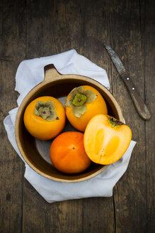 Kaki fruits in ceramic pot - LVF000340