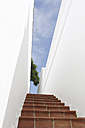 Spain, Lanzarote, Puerto del Carmen, Staircase between white walls - JAT000467