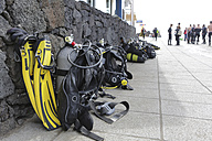 Spain, Lanzarote, Puerto del Carmen, Dive gear leaning against wall at dive center - JAT000464