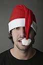Young man wearing Santa hat, close-up - JATF000515