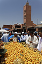 Africa. Morocco, Marrakesh, People at Djemaa el Fna square with Koutoubia Mosque - GF000307
