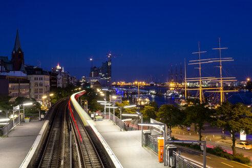 Germany, Hamburg, Ships on River Elbe and moving train at night - NKF000041