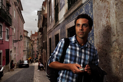 Portugal, Lisboa, Bairro Alto, young man with mobile phone - BIF000070