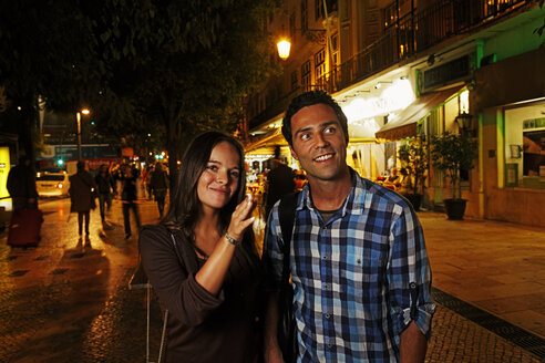 Portugal, Lisboa, Baixa, Rossio, Praca Dom Pedro IV, young couple on the way by night - BIF000013