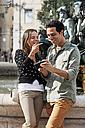 Portugal, Lisboa, Baixa, Rossio, Praca Dom Pedro IV, young couple standing in front of a fountain - BIF000010