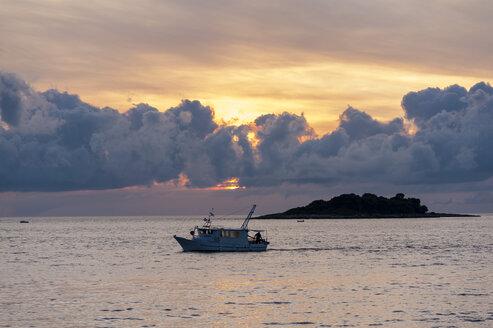 Croatia, Vrsar, Sunset over sea with boat - KJ000261