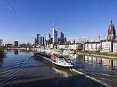 Germany, Hesse, Skyline of Frankfurt with cargo ship on River Main - AM001370