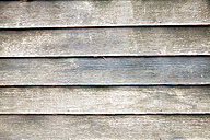 Grey wood paneling of a house facade, close-up - MBEF000886