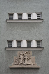 Germany, Bavaria, Munich, part of grey house front with windows and sculpture - AX000578