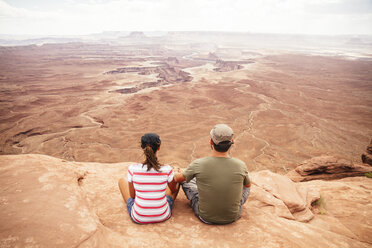 USA, Utah, Young couple looking over Canyonlands National Park - MBEF000887
