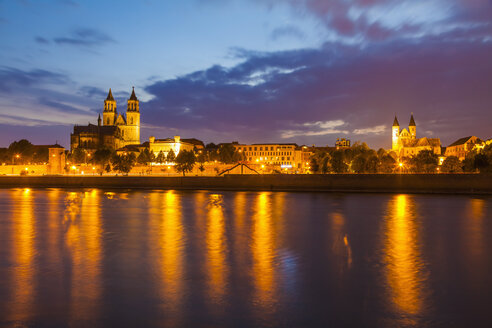 Germany, Saxony-Anhalt, Magdeburg, Cityscape with River Elbe, monastery and cathedral at dusk - WDF002084
