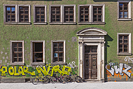 Germany, Saxony-Anhalt, Halle, House front with graffitis and bicycles - WD002016