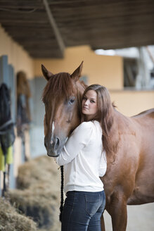 Germany, NRW, Korchenbroich, Young woman with her horse - CLPF000014