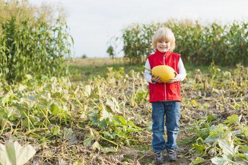 Little boy holding pumpkin - MJF000404
