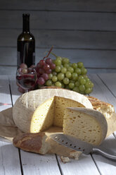 French Bethmale cheese, grapes, baguette and red wine glass and bottle - CS020379
