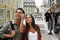 Portugal, Lisboa, Baixa, young couple regarding architecture - BIF000075