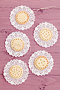Five butter cookies with peekaboo design on crochet tablecloth - ECF000382