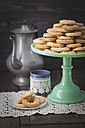 Traditional spritz cookies on green cake plate and coffeepot in background<br /> - ECF000387
