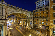 Italy, Genoa, Shopping street Via XX Settembre with Ponte Monumentale at night - AMF001410