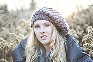 Portrait of young woman wearing wool cap - MAE007544