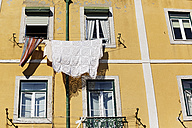 Portugal, Lisbon, Mouraria, part of yellow house front - BIF000121