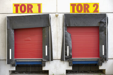 Germany, facade with two red roller shutters - VI000011