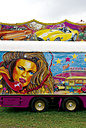 Part of colorful painted transport vehicle at fairground - VI000036