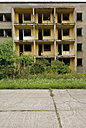 Germany, Brandenburg, Wustermark, Olympic village 1936, facade of decaying concrete tower block - VI000067