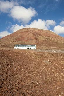 Spain, Fuerteventura, part of volcanic landscape with tour bus - VI000164