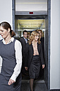Germany, Neuss, Business people geting out of elevator - STKF000795
