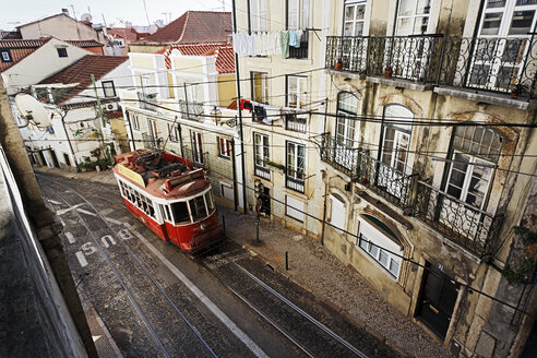 Portugal, Lisboa, Alfama, Electrico at Rua Escolas Gerais - BI000166