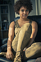 Female Afro-American sitting on couch - NG000062