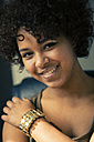 Portrait of smiling female Afro-American with golden make up and bracelet - NG000064